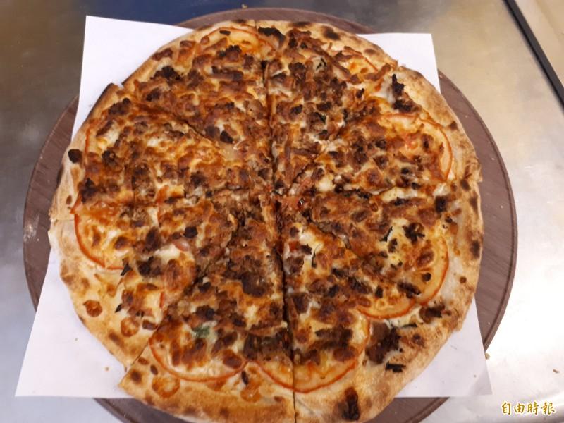 不是泰式打拋豬口味的披薩帶點辣度,美味破表。(記者洪美秀攝)