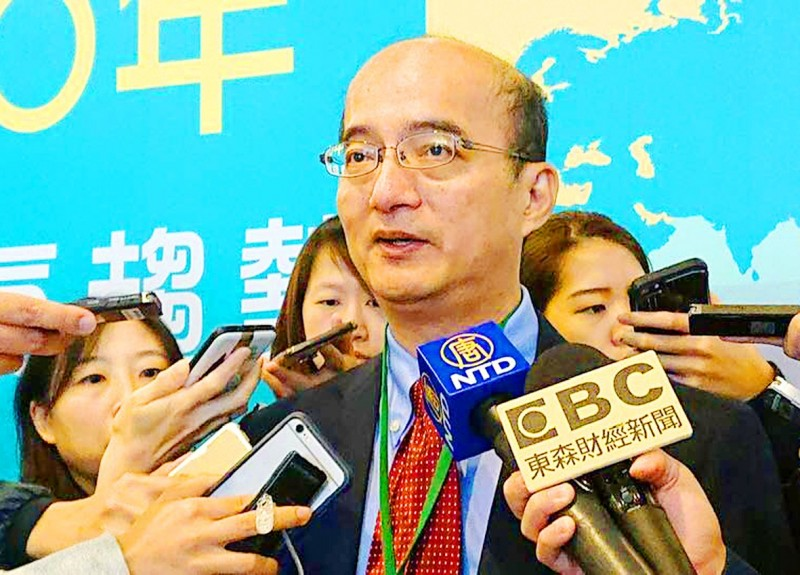 Taiwan Institute for Economic Research president Chang Chien-yi answers questions from reporters in Taipei yesterday. Photo: CNA