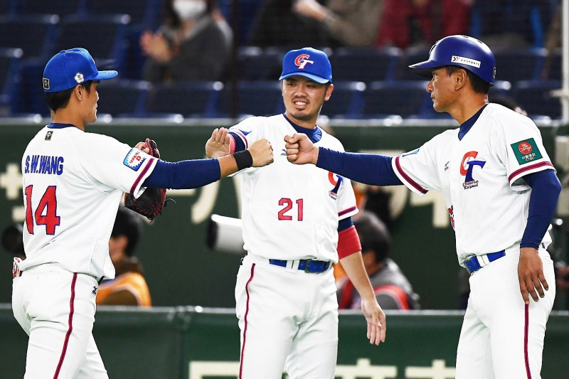Taiwan players celebrate during their Premier 12 super round baseball match against Australia at the Tokyo Dome yesterday.  Photo: AFP