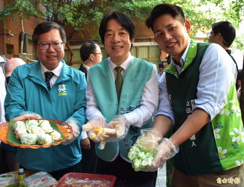 賴清德、鄭文燦、彭俊豪品嚐越南、印尼、泰國等新住民所準備的美食。(記者李容萍攝)