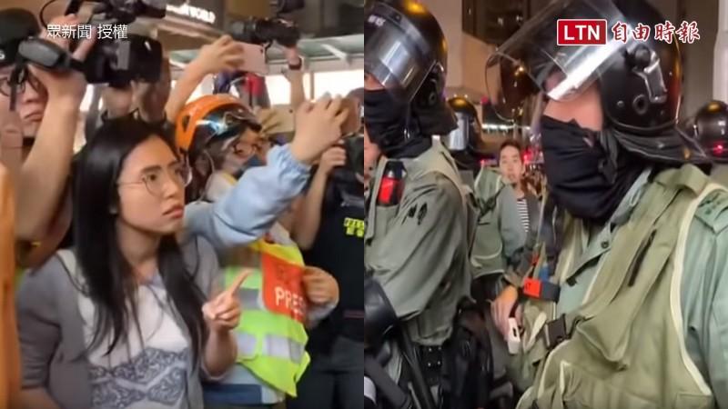 香港街頭12/1深夜再度傳出警民衝突,區議員鄺葆賢(左,灰白衣服女子)不滿警方作為,與警對峙。(眾新聞授權)