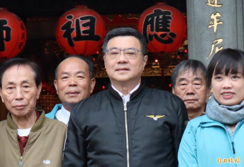 卓榮泰表示,憑國民黨的候選人是韓國瑜,民進黨就應該連任。(記者周湘芸攝)