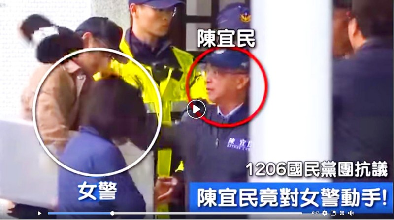 Chinese Nationalist Party (KMT) Legislator Arthur Chen, right, appears to remove a police officer's cap at the Ministry of Foreign Affairs building in Taipei on Friday. Photo courtesy of Democratic Progressive Party Legislator Wang Ting-yu