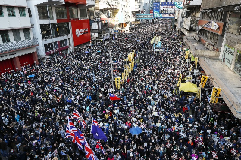 Pro-democracy protesters march on a street in Hong Kong yesterday. Photo: AP