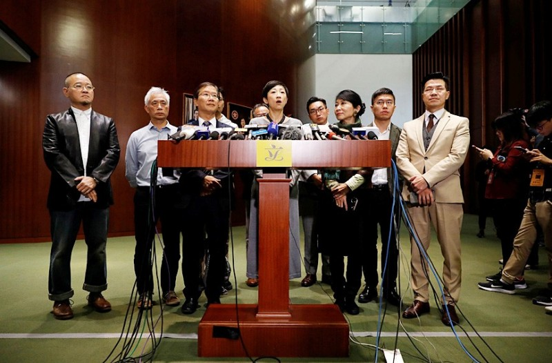 Pro-democracy lawmakers address the media at the Hong Kong Legislative Council yesterday.  Photo: Reuters