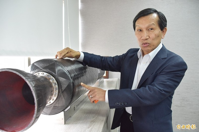 Taiwan Innovative Space Inc chairman Chen Yen-sen points to a model of the company's rocket at his office in Miaoli County on Nov. 22. Photo: Lin Chia-nan, Taipei Times