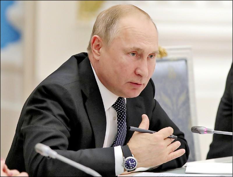 俄羅斯總統普廷二十四日在莫斯科會見國會議員。(路透)