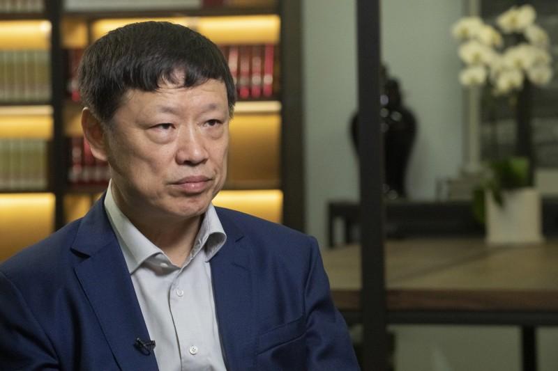 中國黨媒《環球時報》總編輯胡錫進針對中國網友狂喊武統台灣發表評論。(彭博)