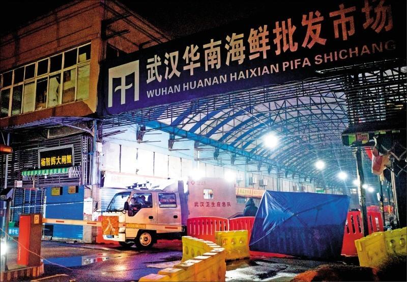 武漢華南海鮮批發市場被中國官方認為是此次疫情起源地。(法新社檔案照)