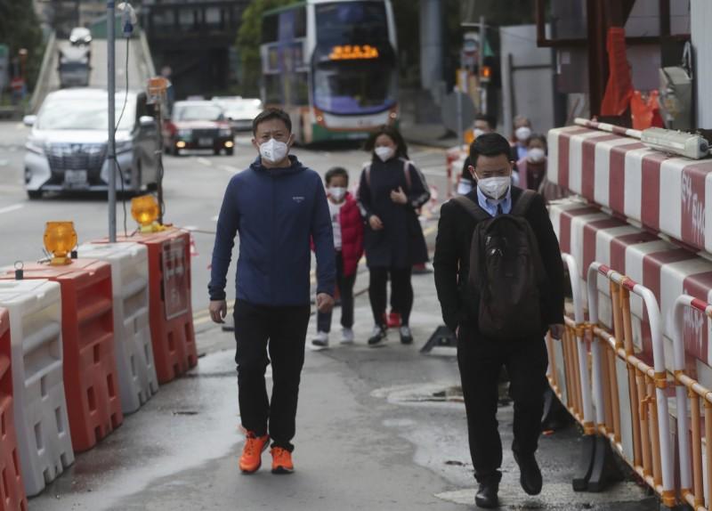 武漢肺炎今日在中國海南省新增9例,更出現當地首名死亡病例。(美聯社)