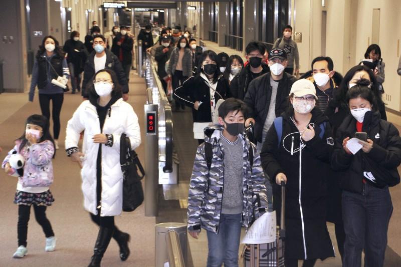 上海旅客因此拒絕與武漢旅客同機,有一名自稱是武漢旅客的網友在協調登機時在微博批評:「這還是同胞嗎?」反遭大批中國網友痛罵。圖為日本機場示意圖。(美聯社)