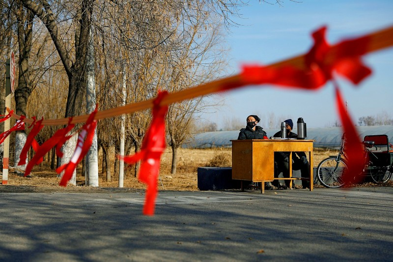 Residents yesterday guard the entrance of a community on the outskirts of Beijing to prevent outsiders from entering as China is hit by a coronavirus outbreak.   Photo: Reuters
