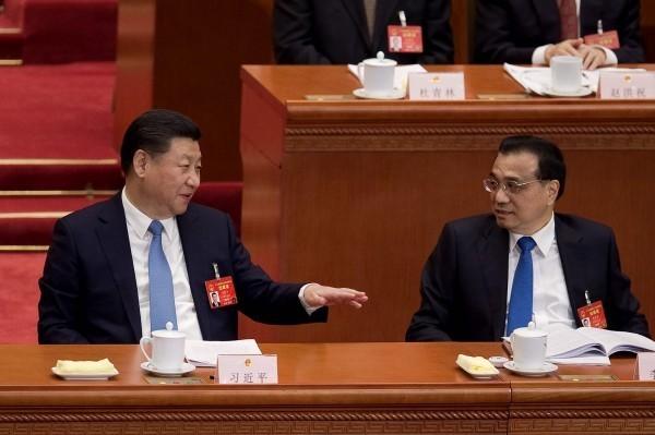 中國武漢肺炎(新型冠狀病毒)疫情蔓延全球,有日媒報導針對中國的應對質疑,中國國家主席習近平的一人獨裁,阻礙了中方對新型冠狀病毒的應對。(法新社)