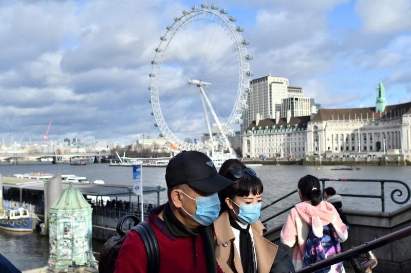 英國衛生部證實,尚有480名自中國武漢入境者行蹤不明。(法新社)