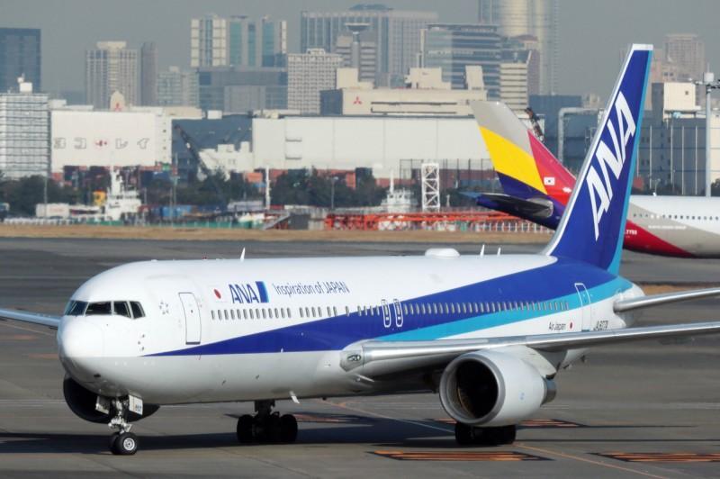 圖為日本1月30日從武漢起飛,在羽田機場降落的撤僑班機。(法新社)