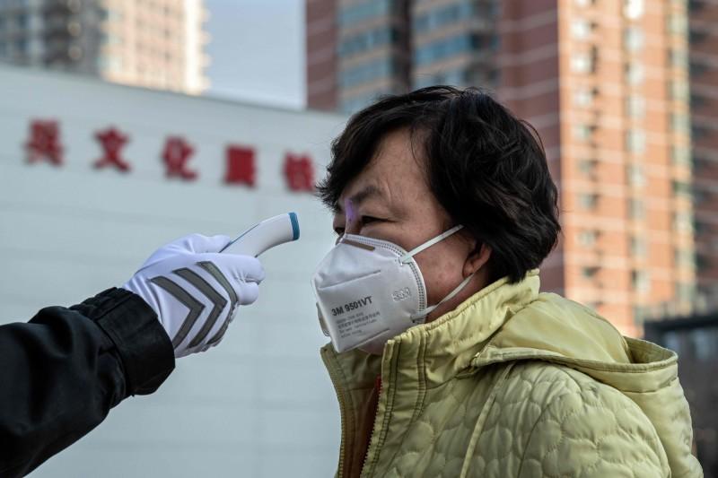 為阻止疫情擴散,中國各市相繼實施「封閉式管理」,自武漢市「封城」以來,中國已有34城市實施大小不一的封鎖措施。(法新社)