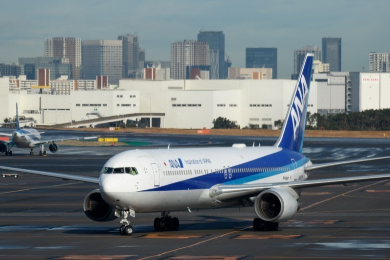 日本宣布,從明(14)日開始,若飛機或船上出現明顯感染者,則乘客皆不得入境。(彭博)