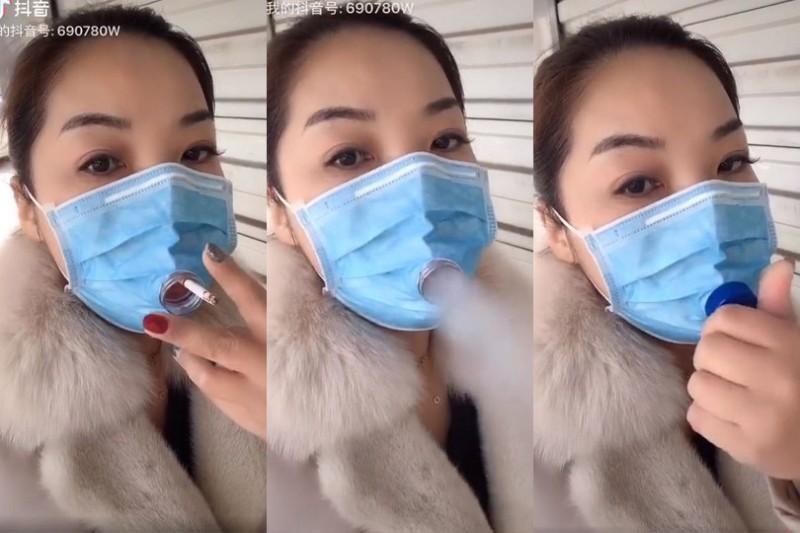 中國網傳一段影片顯示,有人在口罩挖洞,方便吸菸。(擷取自微博)