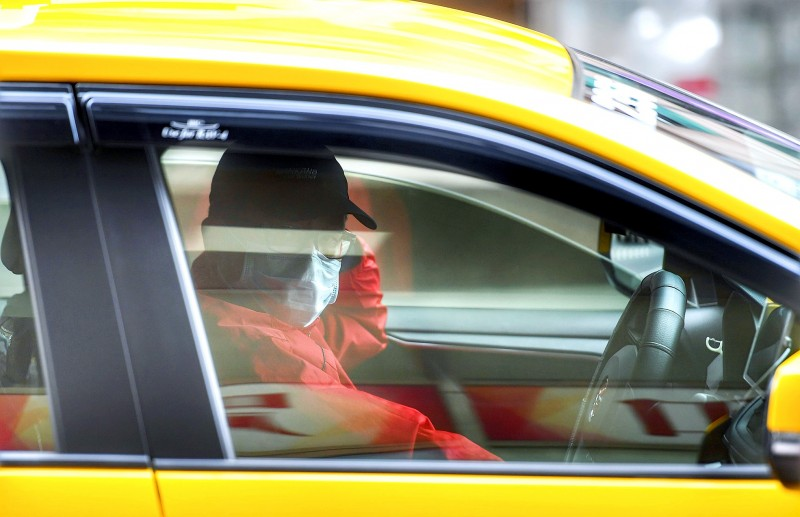 A taxi driver wears a mask in Taipei yesterday. Photo: CNA