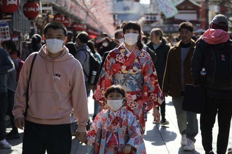 武漢肺炎持續蔓延,日本今天又新增6例,累積84例,也讓不少台灣人取消遊日行程。(美聯社)