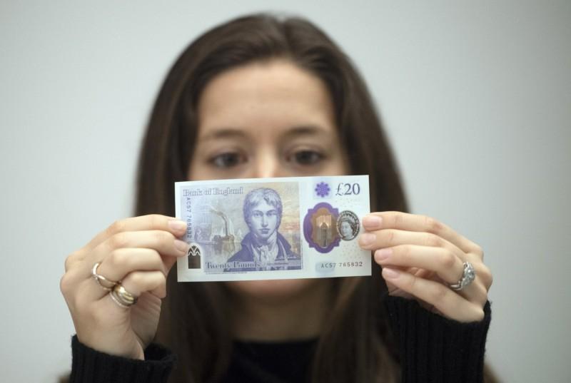 英國開始流通20元英鎊新鈔。(歐新社)