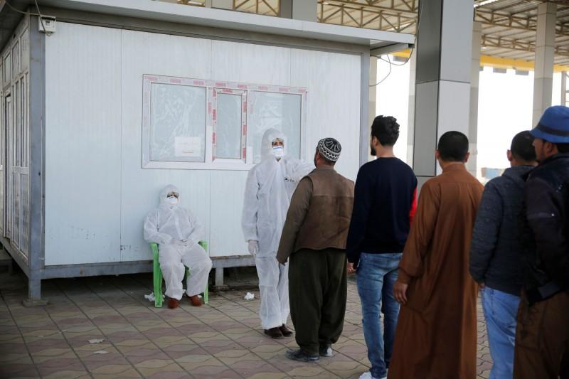 伊拉克衛生部今天(27日)證實首都巴格達增加1例武漢肺炎確診病例,累積確診病例來到6例,圖中人物非當事人。(路透)