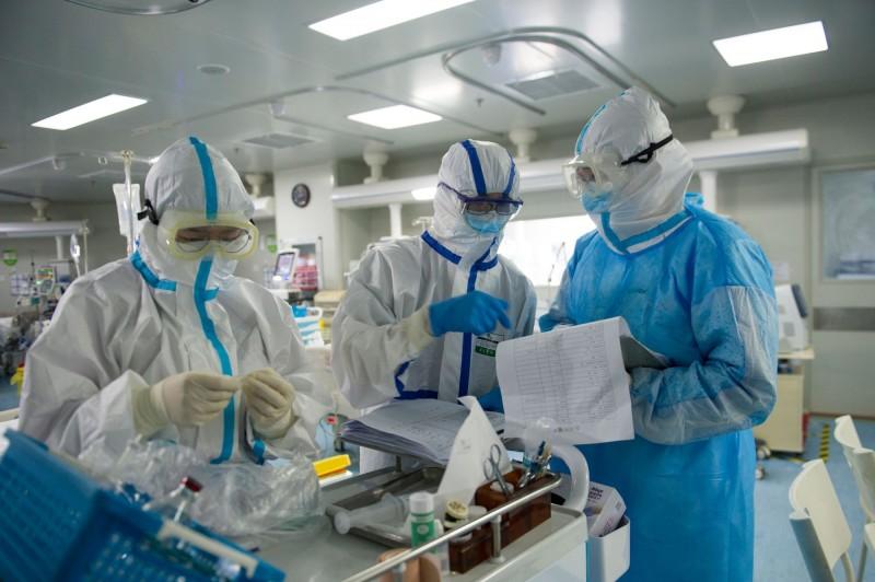 武漢肺炎疫情持續在全球蔓延。(法新社)