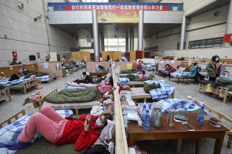 中國被爆用強制手段隔離民眾,各級政府還藉防疫名目趁火打劫。(美聯社)