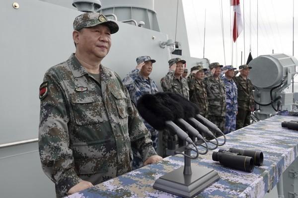 中國國防部28日表示,目前按照領導人習近平(如圖)指示,一邊防疫、一邊練兵。(美聯社檔案照)