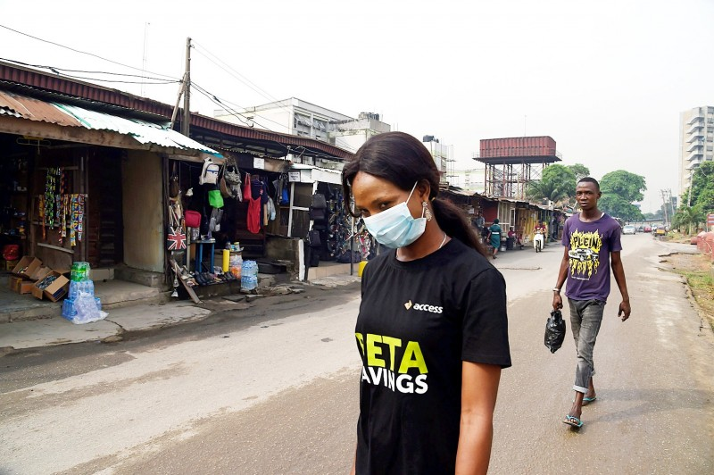 A woman wearing a mask walks along a road in the Yaba area of Lagos, Nigeria, yesterday.  Photo: AFP
