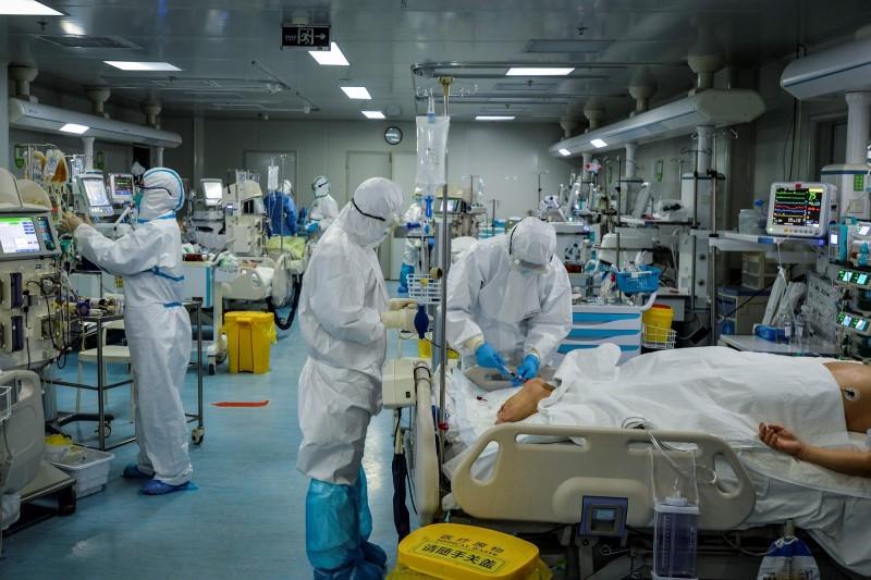 中國武漢爆發的新型冠狀病毒疾病(COVID-19,武漢肺炎)疫情持續延燒。(法新社資料照)