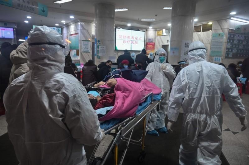 中國國家衛生健康委員會今上午發布疫情統計,11日新增確診病例僅15例,創下1月20日疫情通報以來新低,其中武漢市僅新增8例,首度降至個位數。(法新社)