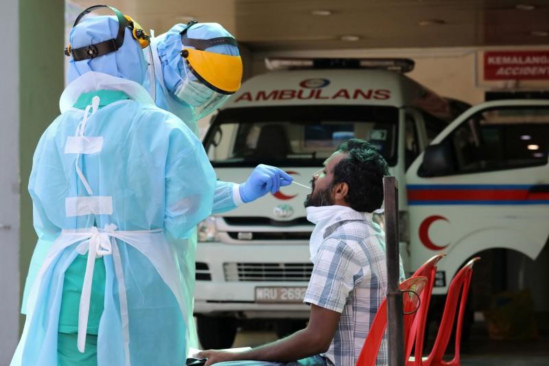 東南亞地區的武漢肺炎(COVID-19)疫情持續升溫,泰國和大馬今日各增加100多例確診。(路透)