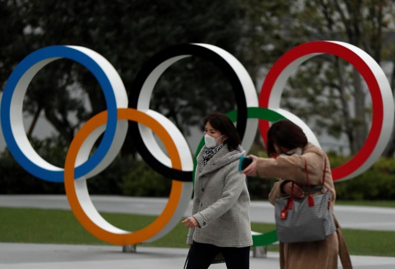 日本東京奧運正式確定延至明年7月23日開幕。(路透)