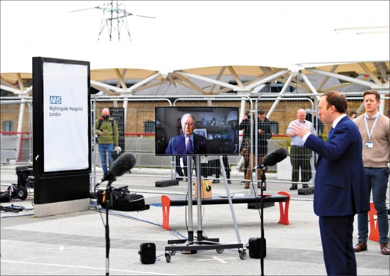 英國倫敦當局將展覽中心改建成野戰醫院「南丁格爾醫院」,耗時九天搭建完成,並在三日啟用,衛生大臣出席啟用典禮。(法新社)