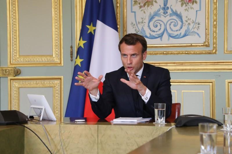 法國總統馬克宏(見圖)表示,不願看到世衛陷入美中之間的戰爭,願意相信、力挺世衛。(路透)