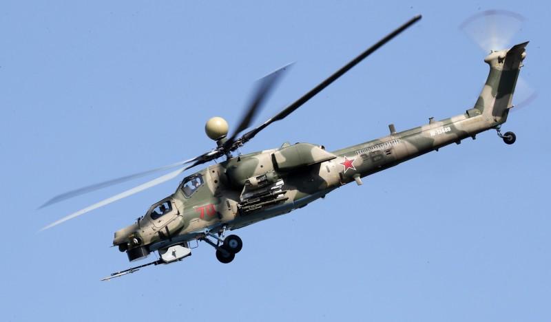 俄羅斯傳出將花費1000億盧布(約新台幣407億元)]建造2艘直升機航母,合約將於4月下旬簽訂。圖為俄羅斯Mi-28攻擊直升機。(歐新社)