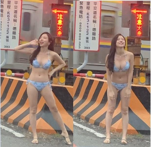 有網友分享行經宜蘭礁溪德陽路段平交道路口時,拍到一名比基尼正妹,讓他又驚又喜詢問大家「有人知道是誰嗎?」(圖擷取自PTT)