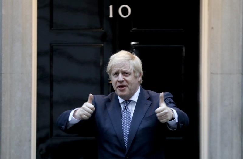 英相強森預告,下週將制定國家重啟計畫。(美聯社)