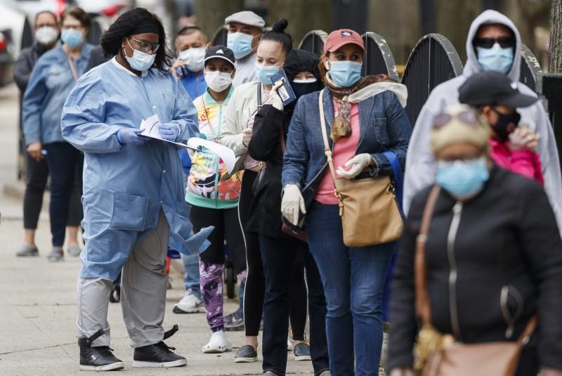 武漢肺炎疫情仍在全球蔓延。(歐新社)