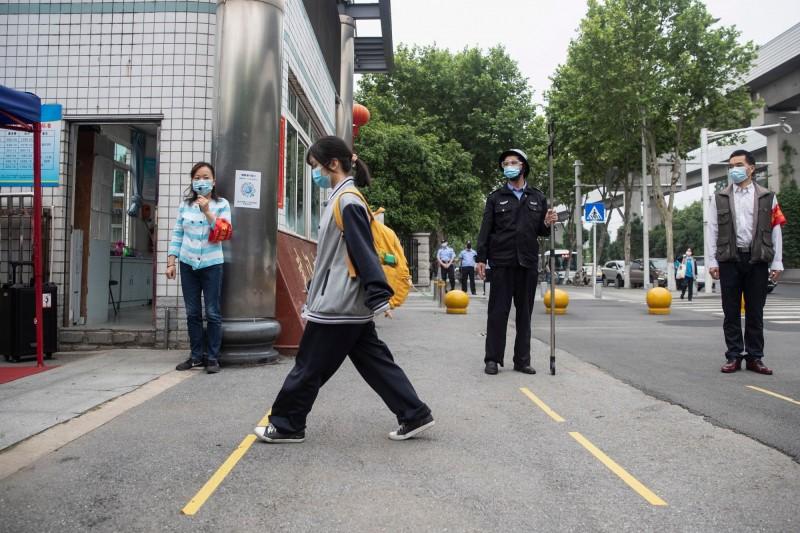 武漢自4月4日以來再度出現本土病例,為時隔36天後再次出現新增確診病例。(法新社)