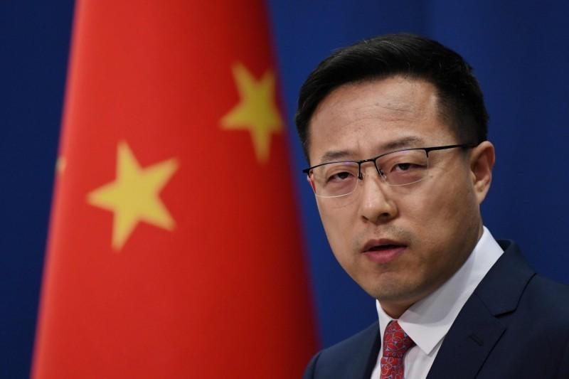 中國外交部發言人趙立堅(見圖)今(12)日回應,這不是什麼秘密,還反嗆台灣「炒冷飯」是借疫情搞政治操弄。(法新社)