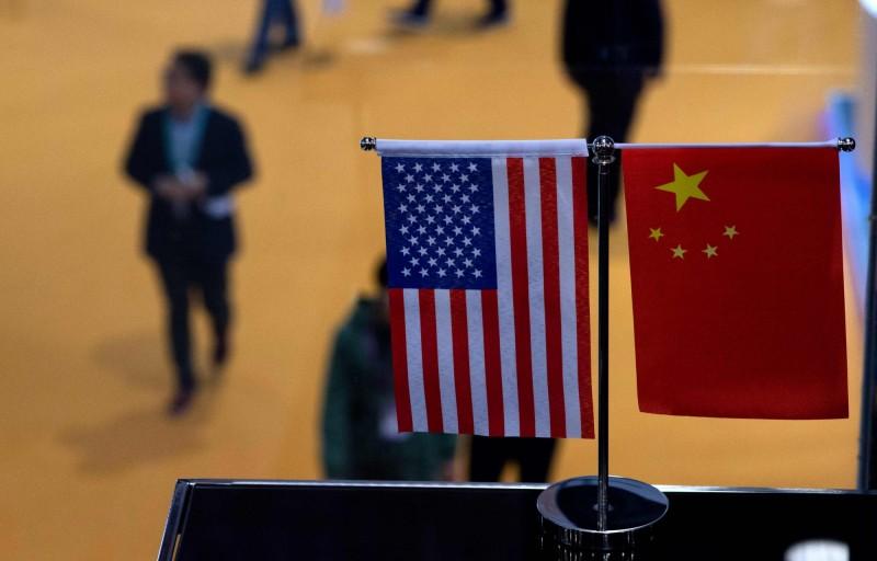 美國與中國在網路上為了台灣是否參與WHA隔空互嗆,美國問中國是否合作,中國則稱個別國家不惜綁架WHA、損害全球抗疫合作。(法新社資料照)
