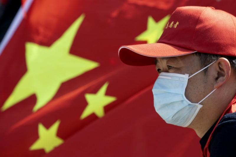 武漢肺炎激化美中對立,中國官媒《環球時報》近期頭版標題有7成以批評美國為主。(美聯社檔案照)