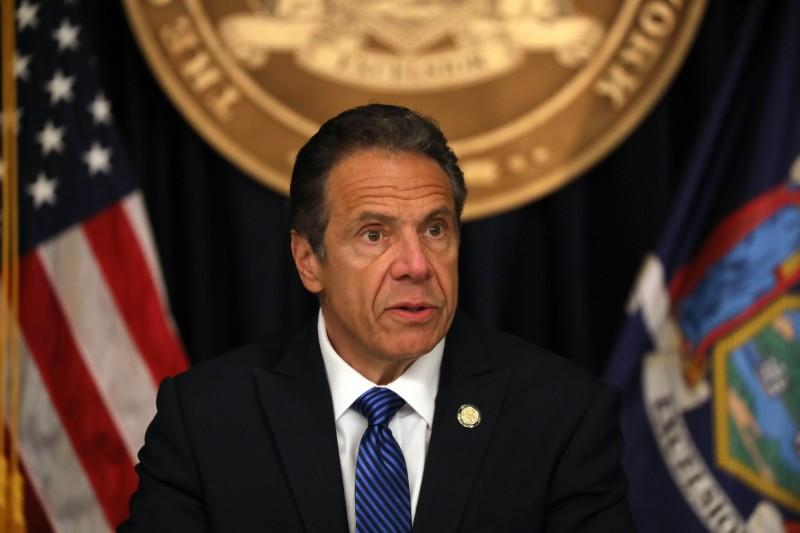 紐約州長古莫在當地時間23日宣布新增84例死亡,創下3月24日以來最低紀錄。(法新社)
