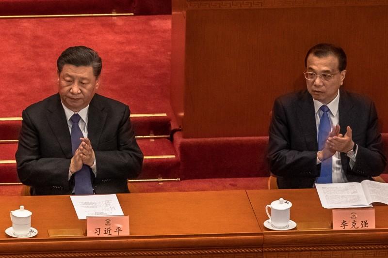 中國國家主席習近平(左)與總理李克強27日出席全國政協會議閉幕典禮。 (歐新社)
