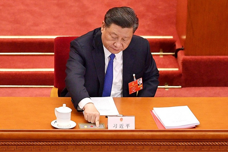 Chinese President Xi Jinping votes to pass a security law on Hong Kong at a session of China's National People's Congress at the Great Hall of the People in Beijing yesterday. Photo: AFP