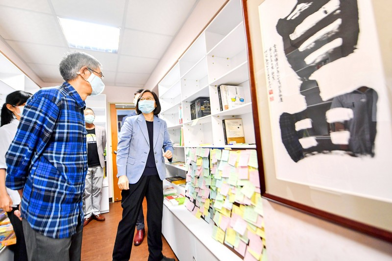 "President Tsai Ing-wen, right, speaks with Causeway Bay Books manager Lam Wing-kei at the store in Taipei yesterday next to calligraphy with Chinese characters for ""freedom.""  Photo: CNA"