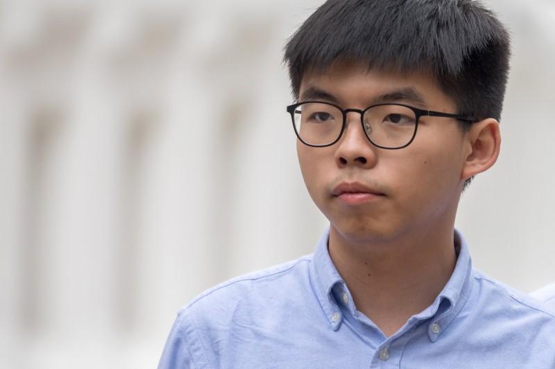 高雄市長韓國瑜被罷免,香港眾志秘書長黃之鋒在臉書表示「台灣人今天的抉擇正是拒絕一個走進中聯辦、對中共頻頻示好的市長」。(彭博資料照)