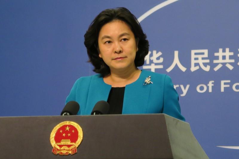 中國外交部發言人華春瑩(見圖)反嗆,中方始終支持世衛組織,美國才該邀請WHO專家去考察。(中央社資料照)